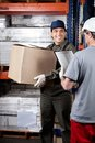 Foreman looking at supervisor with clipboard cardboard box holding warehouse Royalty Free Stock Photos