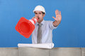 Foreman screaming into cone Stock Images