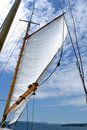 Foresail and Wooden Mast of Schooner Sailboat Stock Image