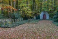 Forest cemetary with chapel in late autumn leaves Stock Image