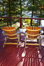 Forest cottage deck and chairs Royalty Free Stock Photos