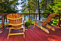 Forest cottage deck and chairs Royalty Free Stock Images