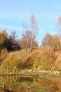 Forest lake in the autumn blue sky Stock Photography