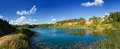 Forest lake panoramic view landscape of with trees and country road on the lakesides Stock Images