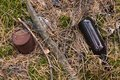 Forest pollution with garbage plastic bottles, glass bottles, metal rust cans