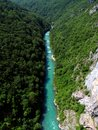 Forest river aerial view montenegro of a flowing thru hillside tara canyon photo taken on Royalty Free Stock Images