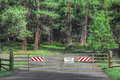 Forest road closed at times roads are into forested areas Royalty Free Stock Photo