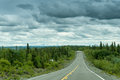 Forest road empty curved into a alaska usa Royalty Free Stock Photo