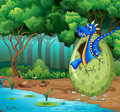 Forest scene with blue dragon hatching egg Royalty Free Stock Photo