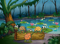 A forest with turtles and fishes at the pond illustration of Royalty Free Stock Photo