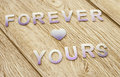 Forever yours on wooden background wallpaper Stock Photos