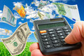 Forex transactions hand with calculator and bills of different countries against the sky Stock Image