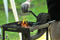 Forge blacksmith heat iron to Stock Photo