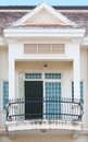 Forged balcony a in a colonial style house Stock Photos