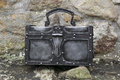 Forged chest nice on stone wall Stock Image