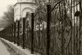 Forged fence beautiful around the church Stock Photos