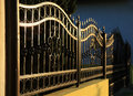 Forged iron fence decorative at sunset Stock Photography
