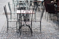 Forged iron furniture at an outdoor restaurant Stock Photos