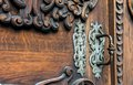 Forged parts on a massive oak door Royalty Free Stock Photography