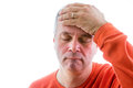 Forgetful man holding his hand to his forehead Royalty Free Stock Photo