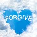 Forgive concept tell by shy cloud nature sky word inside heart shape Royalty Free Stock Photos