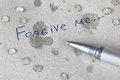 Forgive me words on paper with tears Royalty Free Stock Photography