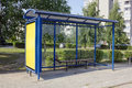 Forgotten empty bus stop the mass production in the sleepy summer small city hot sunny day urban landscape Stock Photography