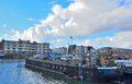 The forgotten harbor in ghent living boats and factories belgium march called dok noord a stormy sky Royalty Free Stock Photos