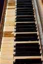 Forgotten piano keys of a dirty old upright grand Royalty Free Stock Photo