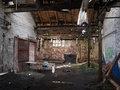 Forgotten places view with sun rays in old abandoned factory Royalty Free Stock Photos