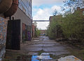 Forgotten places view with sun rays in old abandoned factory Royalty Free Stock Photo