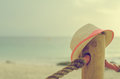 Forgotten straw hat against sea background Royalty Free Stock Image