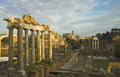 The fori imperiali in rome italy view of roman forum with saturn s temple and coloseum foreground ancient roman ruins Stock Photography