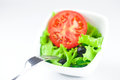Fork black olive lettuce tomato cucumber and pepper in a bowl Royalty Free Stock Images