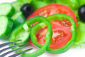 Fork black olive lettuce tomato cucumber and pepper in a bowl Royalty Free Stock Image