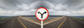 Fork junction sign with crossroads spliting in two way Royalty Free Stock Photo