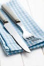 Fork and knife on checkered napkin Stock Photo