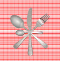 Fork, knife and spoon on checkered tablecloth Stock Photos