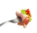 Fork with meat and tomato Royalty Free Stock Photo