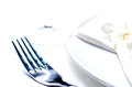 Fork and plate white napkin on light background high key image Royalty Free Stock Photo