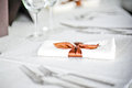 Fork and spoon table decoration with ribbon over a white restaurant napkin Royalty Free Stock Photo