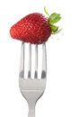 Fork with strawberry on white background Stock Photography