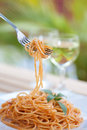 Forkful of spaghetti with tomato sauce Stock Photo