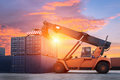Forklift handling container box loading to freight train in import, export Royalty Free Stock Photo