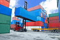 Forklift handling container box loading to truck i Royalty Free Stock Photo