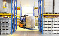 Forklift loader and worker at Royalty Free Stock Photo