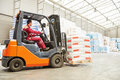 Forklift loader working in warehouse Royalty Free Stock Photo