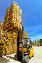 Forklift loads Stock Photo