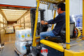 Forklift in motion at warehouse operator lifting liquid containers the industrial district of rome Royalty Free Stock Image