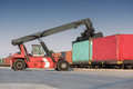 forklift moving containers Royalty Free Stock Photo